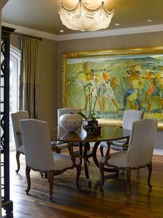 Large scale art in Dining Room becomes the focal point. Interior Design by Bruce Kading.