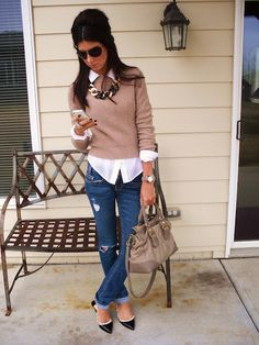 Great office look!  Sweater over a button up shirt, chunky necklace.