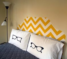 Fake a headboard. LOVE the pillows!!! could do that with even bigger glasses