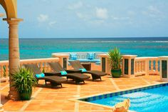 Villa Amarilla, an incredible vacation home on the Caribbean island of Anguilla. You can rent this and comes with full staff! Can you imagine? WOW.