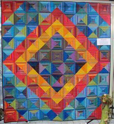 Times Square quilt by Jill Schlageter, quilted by Melanie Meadows, in: Quilts! Quilts!! Quilts!!! 3rd edition by Diana McClun and Laura Nownes.  Photo by The Plaid Portico. time squar, squares, portico, times square, quilts, melani meadow, log cabin, 3rd edit, jill schlaget