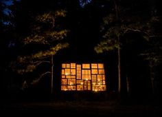 Nick Olson and Lilah Horwitz quit their jobs to build this glass retreat in the mountains of West Virginia for $500 in materials. Read their lovely story at http://yhoo.it/NickLilahGlassCabin
