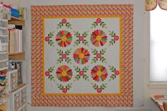 Erin Russek. Miss Kyra Quilt. I like the Dresden plates bordered with the on-point flower & leaf applique corners.