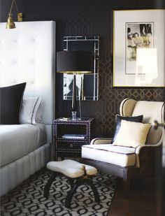 Very elegant look - dark wallpaper, white bed, brass fitting. So glam!