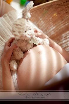 Take photo of belly with stuffed toy then after the baby is born take a picture of the baby with the same toy - frame together.