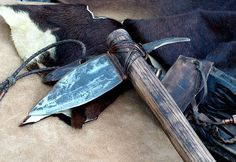 'Hawk Spontoon's are pure weapons.  Forged from a 100 yr. old plow point on charcoal, hot cut, hot filed, quenched in brine water. Haft is 20″ Oak split from firewood, drawknifed, oiled and toasted. No dye. The head is burned threw in the old Celtic way, stuffed with pine pitch glue and wrapped with rawhide. The hand grip is garment leather from a bag and wrapped with deer rawhide.