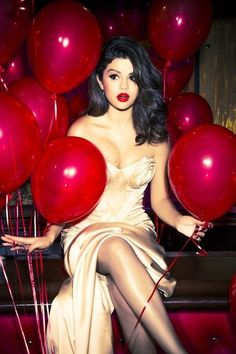 Selena Gomez - Loving this photo shoot love the red of her lips with the balloons
