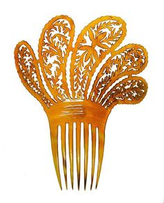 Hair Comb    Amber horn comb with fan shaped filigree top. Made by the French for the general market., c. 1812