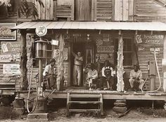 Another great Dorothea Lange photograph from Great Depression. It shows men sitting on porch of country store in Gordonton, North Carolina. Taken in 1939. http://old-photos.blogspot.com/2008/01/country-road.html