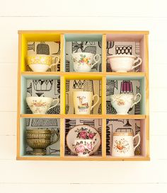 tea cups on a shelf