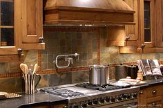 #Kitchen Idea of the Day: Slate tile backsplash with a pot filler faucet.