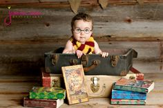 harry potter baby idea! indoor studio photography little boy with glasses inside suitcase surrounded by books