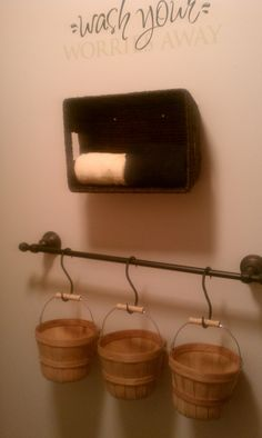 Country decor in the bathroom... except got the idea for galvanized buckets instead.
