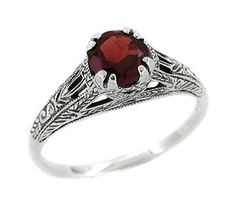 Art Deco Almandine Garnet Filigree Engraved Ring in Sterling Silver:  This stunning Art Deco filigree ring features a securely 8 prong set gorgeous fiery garnet ( January Birthstone--MY birthstone) weighing approximately 0.65 carat, and rust-red in color. Meticulously executed in sterling silver, this beautiful ring is an exact reproduction of an antique original, engraved and crafted in delicate pierced filigree, hand finished in intricate vintage detail.  $105