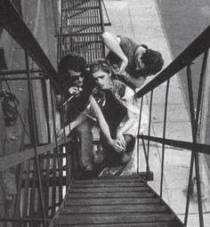 Billy Name and Ondine give Edie Sedgwick a haircut on the fire escape of the Factory