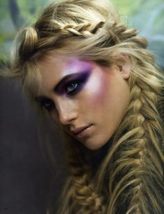 This image is of a beautiful braided hairstyle and iridescent makeup. I would design Miranda's costume emphasizing the light shades of purple and pink. I absolutely love the hairstyle and it would look great on the character.