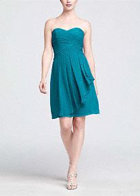 On trend and ultra feminine, this strapless style is great for a bridesmaid and offers plenty of wear-again potential!  Ruching detail shapes a stunning sweetheart neckline that flatters any body type.  Crinkle chiffon flows to create a front cascade that adds dimension and romance.  Short silhouette is versatile and chic making this style a closet staple.  Extra length available in stores.  Fully lined. Back zip. Imported polyester. Dry clean only.  Get inspired by our colors.