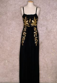 Black silk evening gown with gold beaded floral appliqués, probably European, 1938-1940. Tirelli Trappetti Foundation.