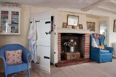 Comfy lloyd loom chair and inglenook in this cottage living room