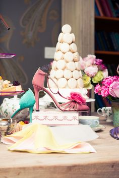 Oh so ladylike. Pink SJP pumps and macaroons...