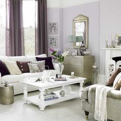 White and purple glamorous living room. I would usually never choose purple for a living room but this works!