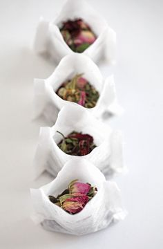 DIY tea bags. Add your favorite loose tea, seal, attach tag, place in a nice container and give as a gift. I would probably add a tea cup or two in the box.