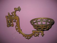 Antique cast iron sconce with oil lamp |