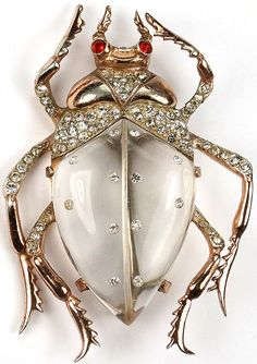 Sterling Corocraft with Pegasus Reference: Schiffer, Fun Jewelry, p. 76, pictured. Patent is reproduced below (scroll down); designer A Katz, dated 1942 - patent is for variant faceted belly bug
