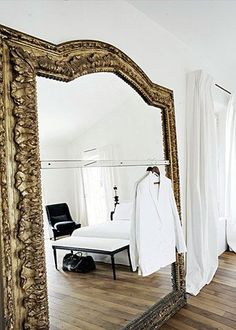 Retail display idea - wall-size mirrors with a rail for hanging clothes