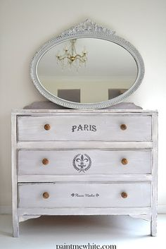 simple dresser and oval mirror