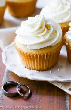 Tender and moist homemade vanilla almond cupcakes topped with creamy white chocolate frosting. A truly elegant treat for the most special day. Today is our wedding day. The day my father will walk me down the aisle towards the new life ahead of me. Bridesmaids dressed in coral, groomsmen donning tuxes, proud parents, elated friends, kick-ass band, …