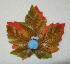 Fall into Scouts: For this swap, all you need are a few artificial fall colored leaves, some googly eyes and glue. Cut off the leaves and glue two eyes on each one. Pin a tag that reads: Fall into Scouts on each one