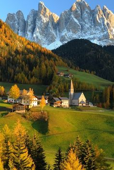 Autumn in Church of St. Magdalena, the Val di Funes, Dolomites, Italy