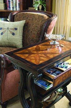 The traditional styling of this accent table will be at home in a variety of settings. It features a beautiful star-like inlay pattern on the top. It has one drawer, two shelves and is finished on all sides. The finish is black with contrasting burl top, shelves, and drawer front. Birch Solids, Birch, Walnut and Oak Burl Veneers.
