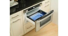 A microwave drawer placed just beneath the countertop is one solution for shorter individuals and for those managing a wheelchair or crutches. It eliminates the sometimes dangerously high reach, and locating it underneath the counter means there is always a landing surface available for hot items as they come out. Younger children have easy access to the unit at this height, too. Controls are also easier to see and read, although taller individuals might have to bend down to read the display.