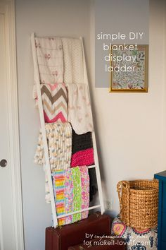 DIY Blanket Storage Display Ladder.....a truly simple design for a nursery or other space! --- Make It and Love It