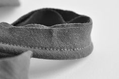 DIY piping cut from old tee shirt -- so no bias needed.