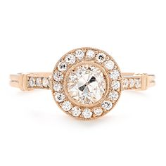 Featuring a brilliantly sparkling center Old European cut diamond surrounded by a halo of pave diamonds, this exquisite rose gold engagement ring is truly unique.  at Greenwich Jewelers