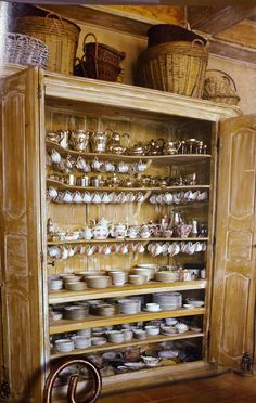 Antique Armoire Used as a China Cabinet.