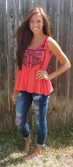coral tank with ripped jeans