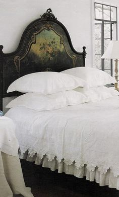 ...beautiful painted headboard and white linens.