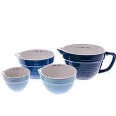 Our sturdy, stylish Stoneware Measuring Cup Set is a must-have for any serious cook. Beautiful shades of solid blue measuring cups nest together in this pretty set, each with vintage-style ridged texture and a handy pouring spout.