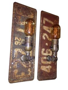 Pair of 1926 license plates turned industrial wall sconces