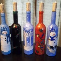 Hand Painted Christmas Wine Bottles... This would be a fun project but I cant paint. lol