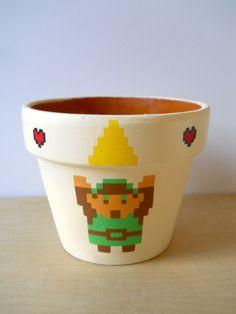 Zelda Nintendo NES video game flower pot II Link with Triforce. $20.00, via Etsy.