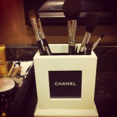 Chanel makeup brush holder! Using a chanel bag! @Heather Dubinetskiy awesome idea! I may just do it.