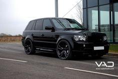 Black Range Rover with black rims...
