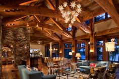Eyebrow beams in ceiling of Great Room (see e.g. the Andesite and Whitefish Yacht Club residences'    Great Rooms), and ornamental aspects to beams in Four Peaks, Quartz & Whitefish Yacht Club residences