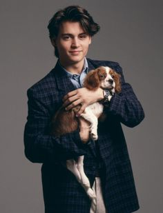 johnny depp with a King Charles pup - and he's just a pup here too!