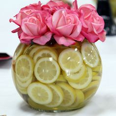 Top a bowl of lemon slices with bright roses for an easy DIY centerpiece